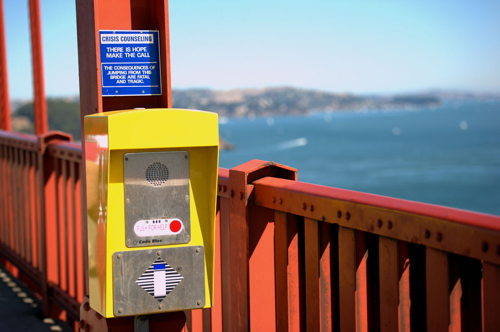A suicide-prevention sign and help line on the Golden Gate Bridge.