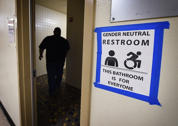 Signs are poseted outside the Santee High School's gender neutral restrooms at their campus in Los Angeles, California on May 4.
