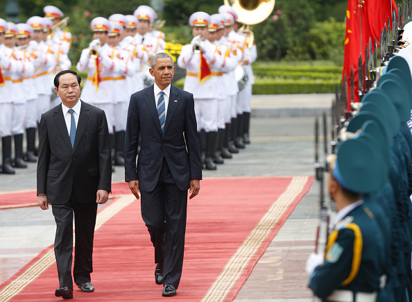 U.S. President Barack Obama (C) walks with his Vietnamese counterpart Tran Dai Quang (L) as they review a guard of honour during a welcoming ceremony at the Presidential Palace in Hanoi on May 23.