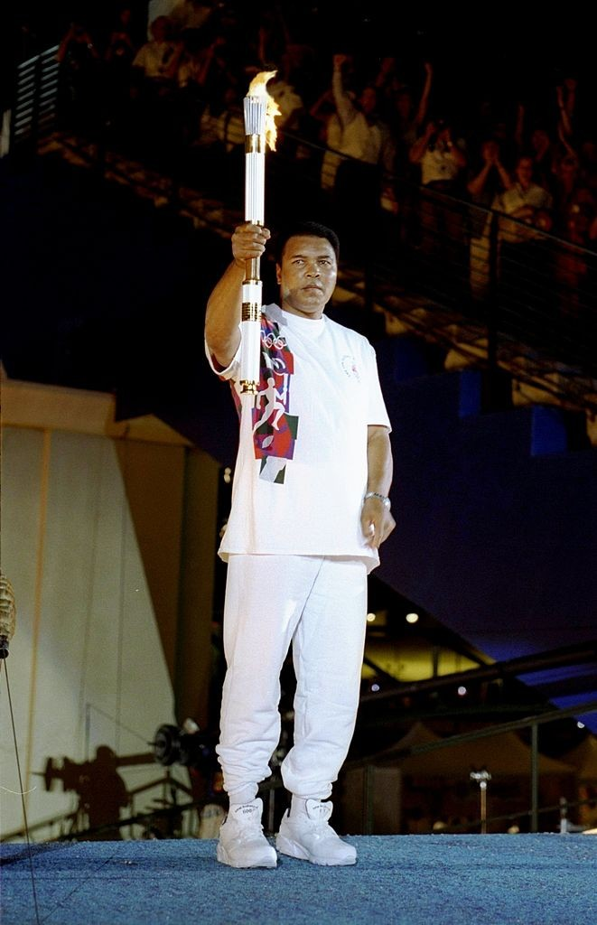 Muhammad Ali holds the torch before lighting the Olympic Flame on July 19,1996 during the Opening Ceremony of the 1996 Centennial Olympic Games in Atlanta, Georgia.