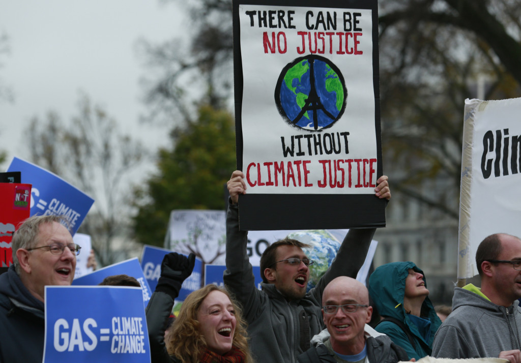 Protesters rally about climate change outside the White House in Washington, DC on November 29, 2015. Hundreds of thousands of people rallied around the world on the eve of a Paris summit aimed at averting catastrophic climate change.