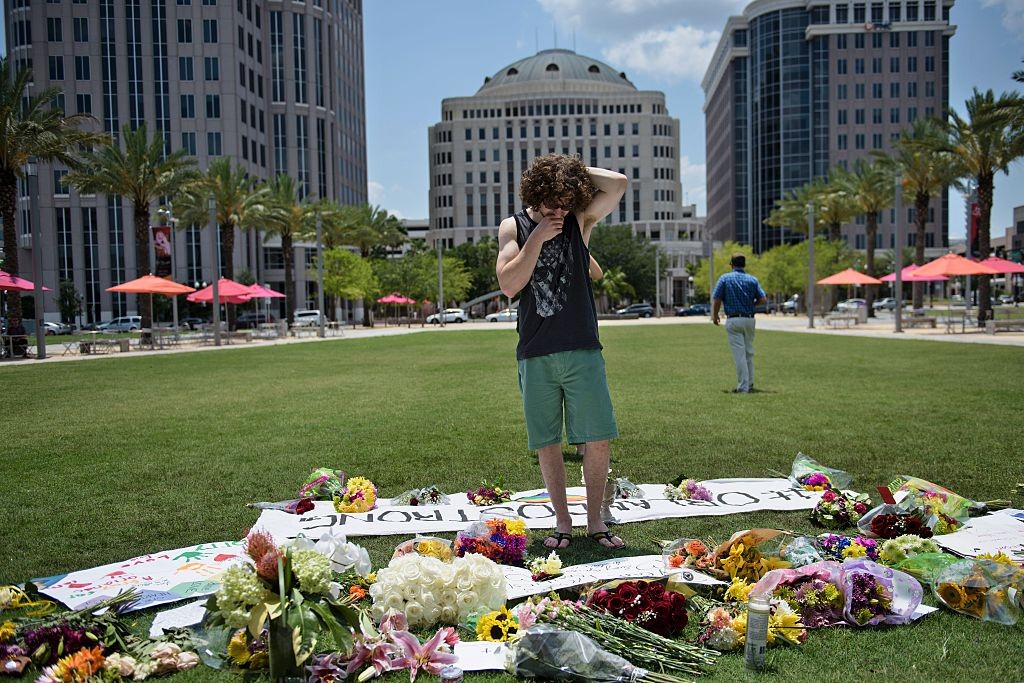 Mike Harrett visits a makeshift memorial June 13 outside the Dr. Phillips Center for the Performing Arts for the mass shooting victims at the Pulse nightclub in Orlando, Florida.