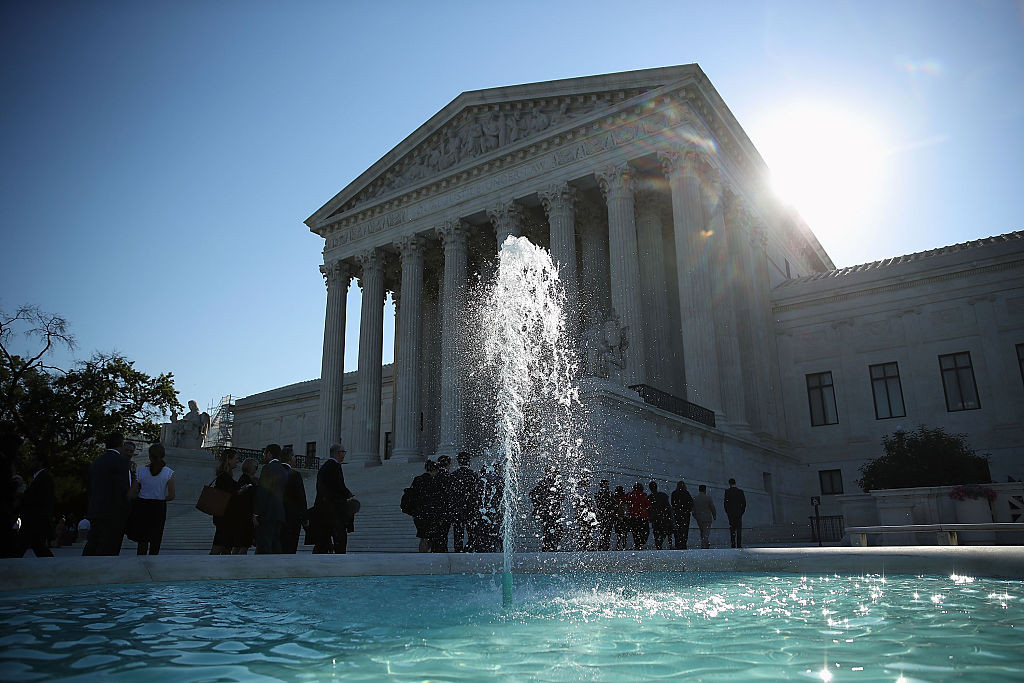 People wait in line to enter the U.S. Supreme Court building June 20, 2016 in Washington, DC.