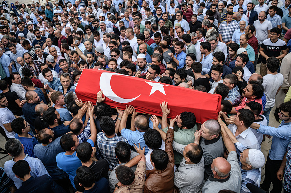 People carry a coffin covered with Turkish national flag of suicide attack victim Hamidullah Safar on June 30 in Istanbul during his funeral two days after a suicide bombing and gun attack targeted Istanbul's airport, killing at least 36 people.