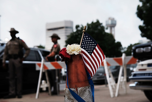 An American flag sits by the scene of Thursday evening's shooting in downtown Dallas on July 11.