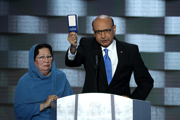 Khizr Khan, father of deceased U.S. soldier Humayun S. M. Khan, holds up a booklet of the U.S. Constitution as he delivers remarks at the Democratic National Convention on July 28 in Philadelphia, Pennsylvania. Standing next to him is his wife, Ghazala Khan.