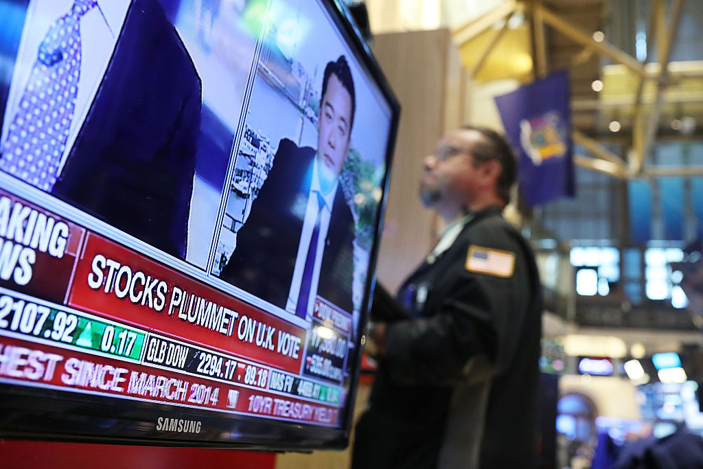 Traders work on the floor of the New York Stock Exchange following news on June 24 that the United Kingdom had voted to leave the European Union. The Dow Jones industrial average quickly fell nearly 500 points on the news with markets around the globe plunging.