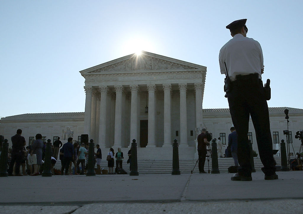 A police officer stands in front of the U.S. Supreme Court building June 20 in Washington, DC.