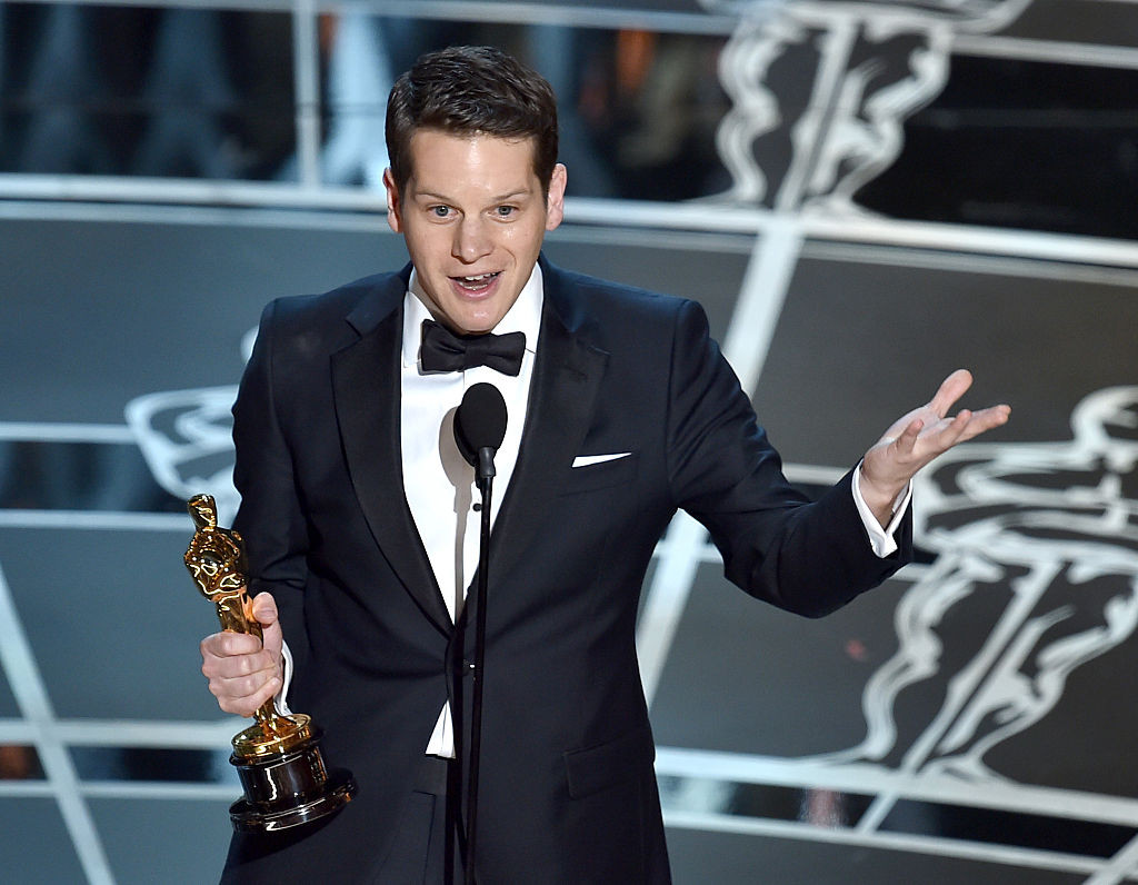 """Screenwriter Graham Moore accepts the Best Adapted Screenplay Award for """"The Imitation Game"""" onstage during the 87th Annual Academy Awards at Dolby Theatre on February 22, 2015 in Hollywood, California."""