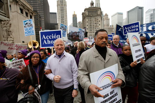 Andy Stern (L), then president of the SEIU leads a demonstration for bank reform with Jesse Jackson (R), president and founder of the Rainbow PUSH Coalition, in October 2009 in Chicago, Illinois.