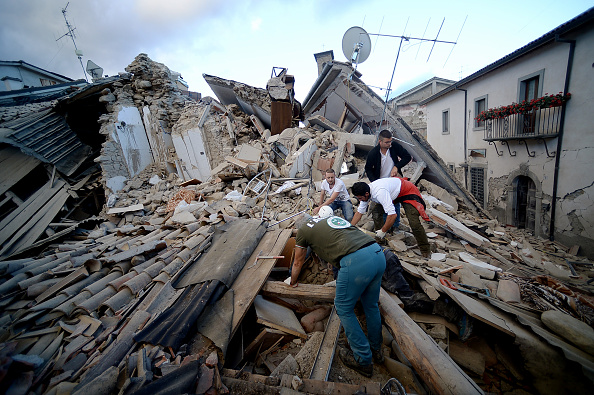 Residents of Amatrice, Italy search for victims in the rubble after a powerful 6.2-magnitude earthquake hit on August 24, 2016.