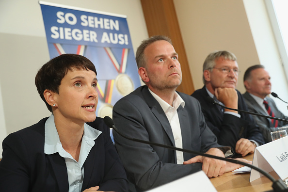 Representatives from Germany's Alternative fuer Deutschland (AfD) political party speak at a press conference under a banner that reads: 'This is what winners look like' on September 5 in Berlin, Germany. The AfD, a newcomer populist party, has managed to gain a strong following nationwide with an immigration-critical platform.