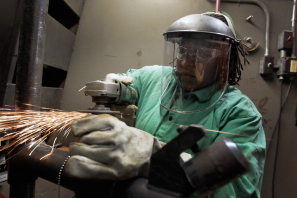 Caundra Ballard uses a grinder to prepare pipes for a weld as she continues her education as a pipefitter at the Air Conditioning, Refrigeration and Pipefitting Education Center in Opa Locka, Florida.
