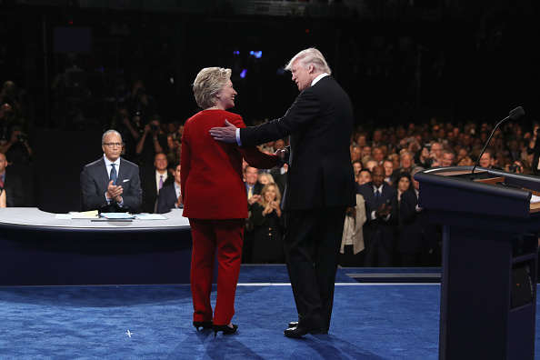Democratic presidential nominee Hillary Clinton shakes hands with Republican presidential nominee Donald Trump during the Presidential Debate at Hofstra University on September 26 in Hempstead, New York.