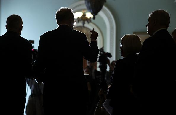 U.S. Senate Minority Leader Sen. Harry Reid (D-NV), Sen. Charles Schumer (D-NY), Sen. Patty Murray (D-WA) and Senate Minority Whip Sen. Richard Durbin (D-IL) (L-R) speak to members of the media during a news briefing at the Capitol September 27, in Washington, DC.