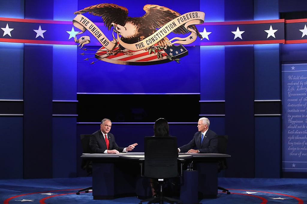 Democratic vice presidential nominee Tim Kaine (L) and Republican vice presidential nominee Mike Pence (R) debate as moderator Elaine Quijano (C) listens during the Vice Presidential Debate at Longwood University on October 4, 2016 in Farmville, Virginia.