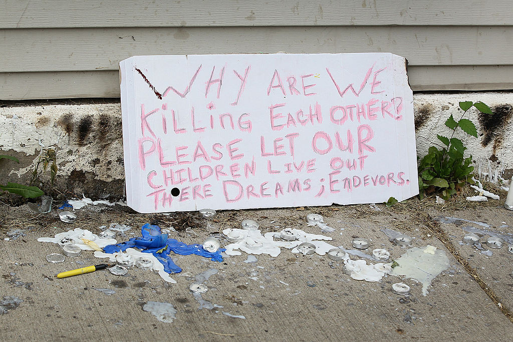 CHICAGO, IL - JULY 20:  A sign from a memorial service for Shamiya Adams on July 20, 2014 in Chicago, Illinois. Adams, 11, was killed  when a stray bullet flew through an open window and struck her in the head.  (Photo by Scott Olson/Getty Images)