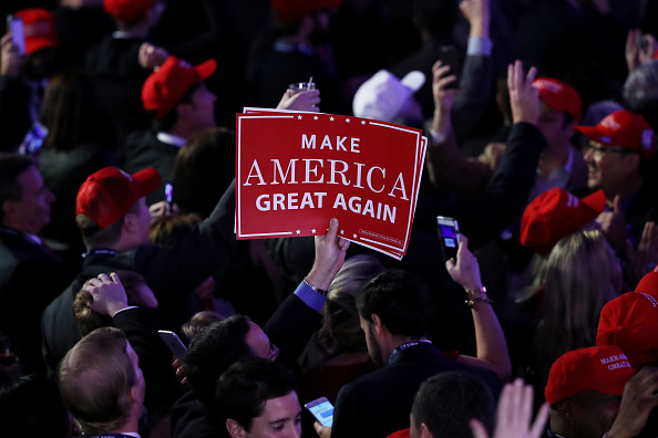 """An attendee of Donald Trump's victory rally in New York City holds up a sign  that reads """"Make America Great Again."""""""