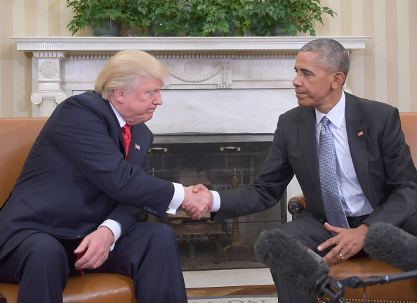 US President Barack Obama shakes hands as he meets with Republican President-elect Donald Trump on transition planning in the Oval Office at the White House.