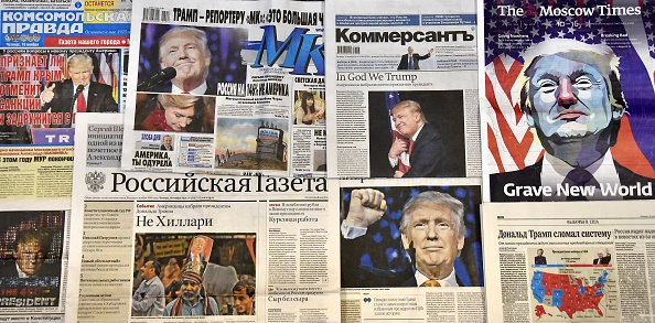 This photo illustration taken in Moscow on November 10, 2016 shows front pages of Russian newspapers reporting on the victory of Donald Trump in the US presidential election.