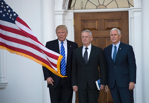 US President-elect Donald Trump poses for a photo with US Marines General (Ret.) James Mattis and Vice President-elect Mike Pence on Nov. 19 at the clubhouse at Trump National Golf Club in Bedminster, New Jersey.