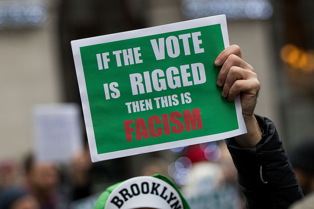 NEW YORK, NY - DECEMBER 5: A supporter holds up a sign while Green Party presidential candidate Jill Stein speaks at a news conference on Fifth Avenue across the street from Trump Tower December 5, 2016 in New York City. Stein, who has launched recount efforts in Michigan and Wisconsin, spoke about demanding a statewide recount on constitutional grounds in Pennsylvania.  (Photo by Drew Angerer/Getty Images)