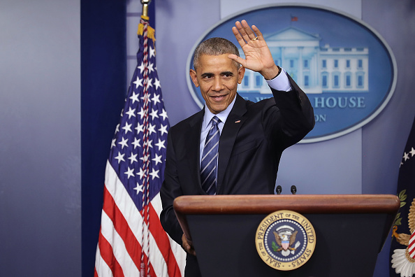 President Obama waves goodbye at the conclusion of what may be the last news conference of his presidency on December 16.