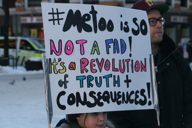 A young girl holds a sign at a protest in January 2018.