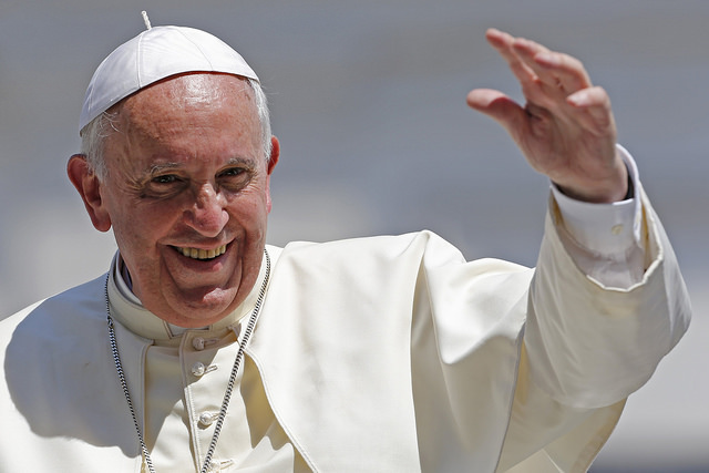Pope Francis waves after leading his weekly general audience at St. Peter's Square at the Vatican June 11, 2014.