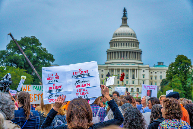 Protesters gather in front of the Capitol Building in Washington DC in opposition to Brett Kavanaugh's nomination to the Supreme Court.