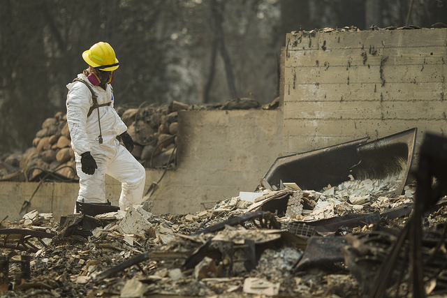 A member of the California National Guard conducts search and debris clearing operations, Nov. 17, 2018, in Paradise, California, following the deadly Camp Fire. More frequent and intense wildfires are one of the many consequences of climate change discussed in a recent report released by the U.S. government.