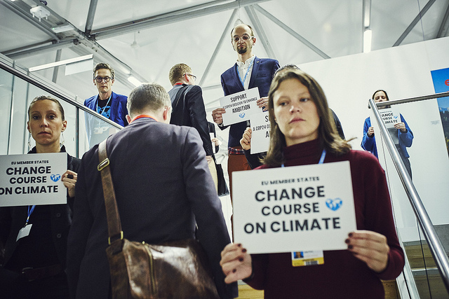Activists encouraging EU member countries' delegates to enhance climate ambition at the U.N.'s recent conference on climate change in Poland.