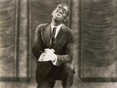 "Warner Bros. publicity photo for the film The Jazz Singer (1927), featuring Al Jolson as Jack Robin, in blackface, performing ""My Mammy"""