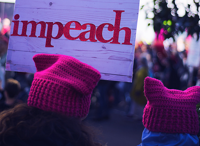 A sign from the 2017 Women's March in Oakland, CA. Calls for impeachment started as soon as President Trump took office.