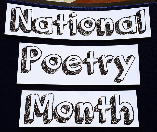 "A sign at College of the Mainland Library in Texas  City, Texas, announces April as ""National Poetry Month."""