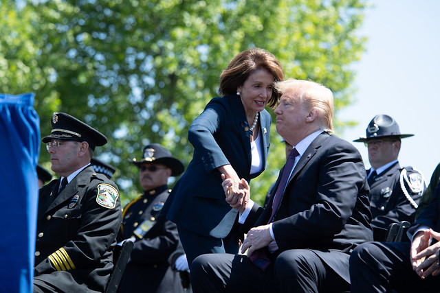 President Trump shakes hands with House Speaker Nancy Pelosi at  the 38th Annual National Peace Officers' Memorial Service at the Capitol.