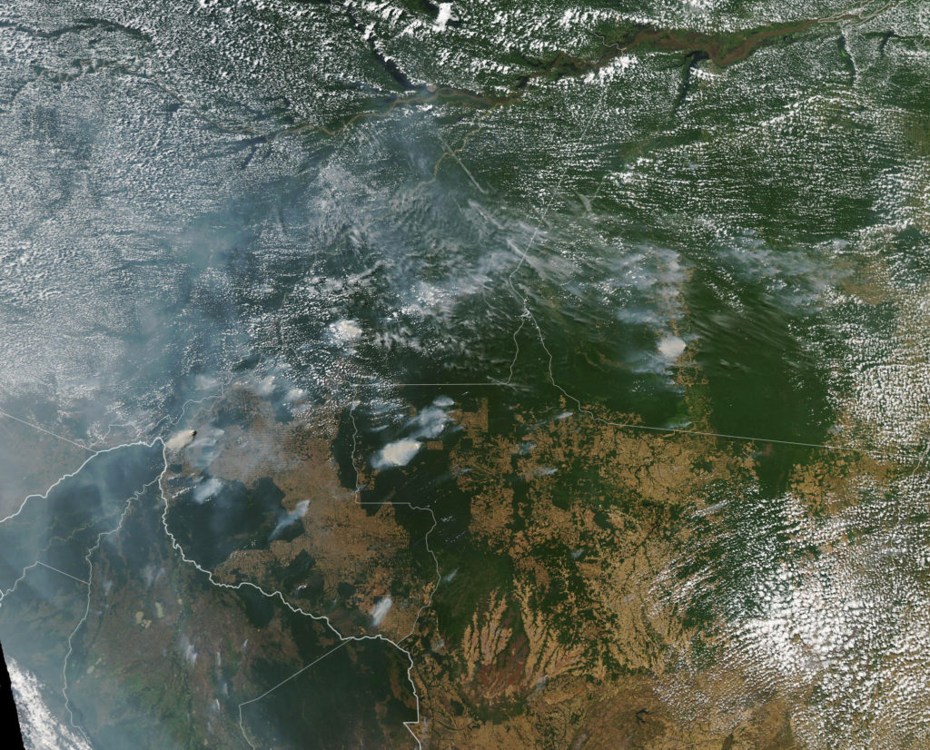 An image taken by a NASA satellite shows fires burning throughout the Amazon rainforest.