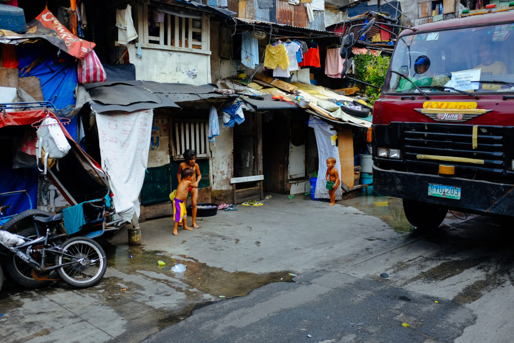 Children play in the street in Manila, Philippines.
