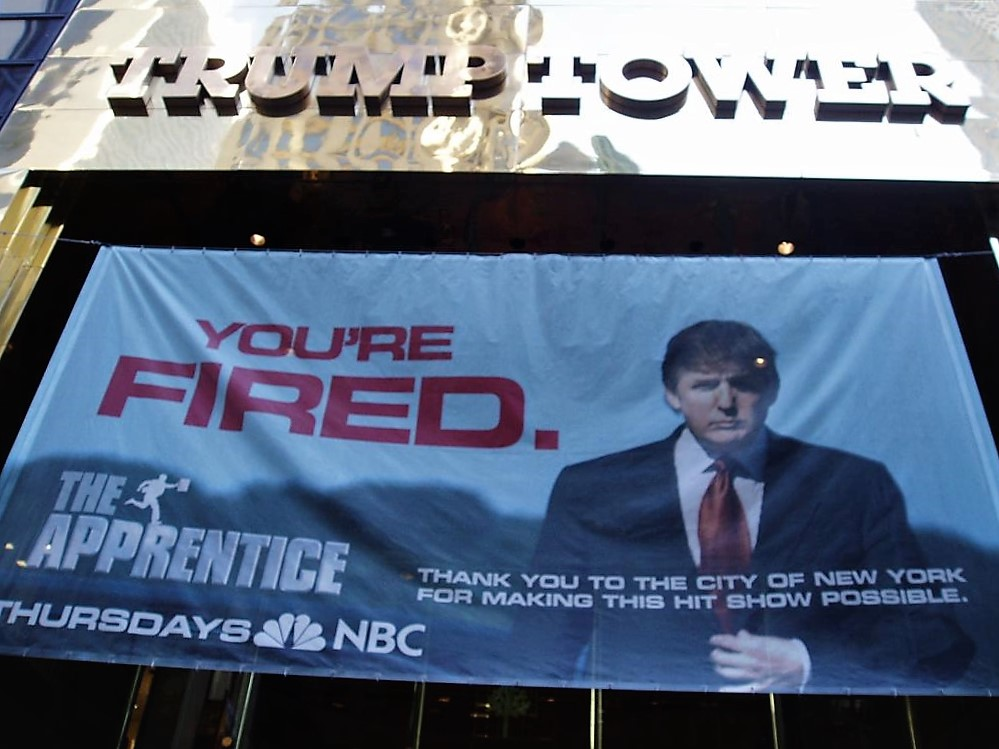 A photo from 2005 shows a banner advertising The Apprentice hanging outside Trump Tower.