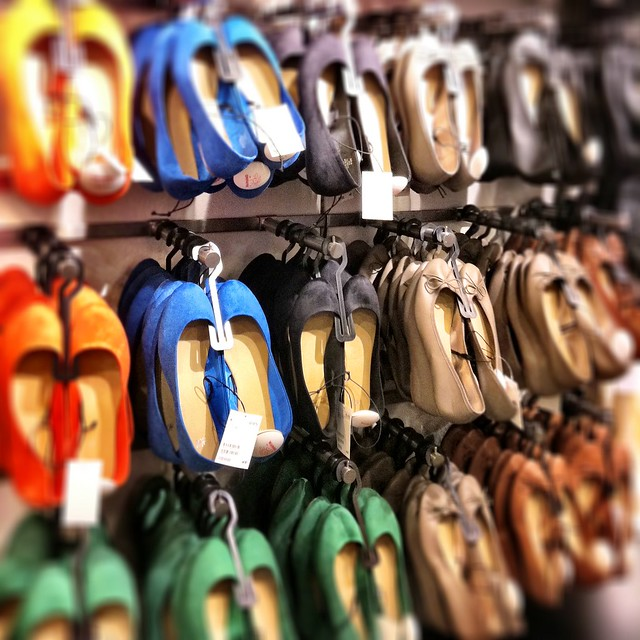 Rows of shoes at H&M. Author Dana Thomas says mass produced clothing like this is an environmental disaster.