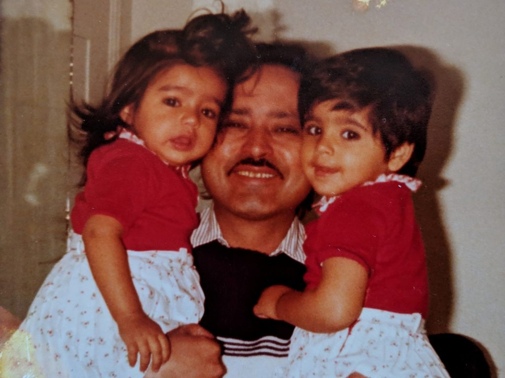 "Aarti Shahani, author of the new memoir, ""Here We Are,"" pictured with her father and sister."