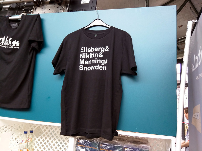 A t-shirt lists the names of well known U.S. whistleblowers.