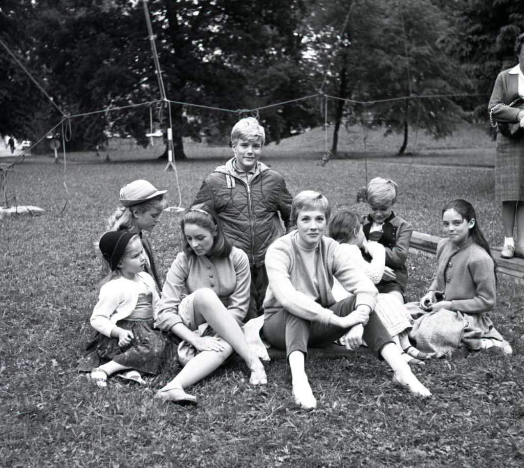 """Julie Andrews and the cast who played the von Trapp children filming """"The Sound of Music"""" on location in Salzburg."""