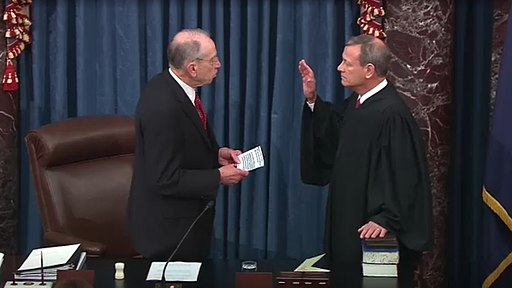 Senator Chuck Grassley administers the oath of office to Chief Justice John Roberts in the opening of the impeachment trial of President Donald Trump.
