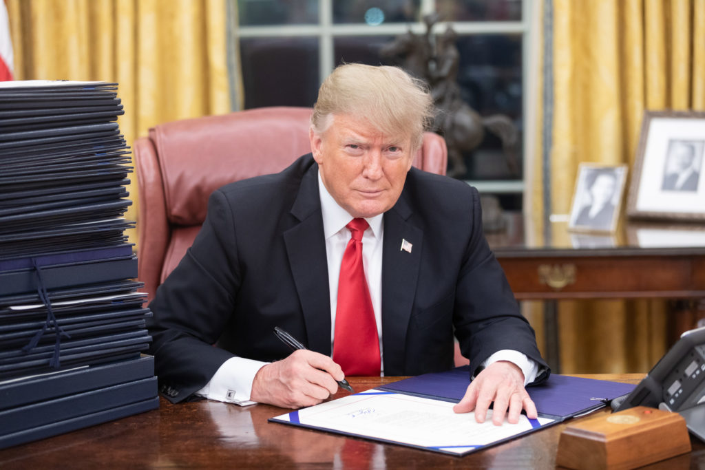 Pres. Donald Trump seated at his desk in the Oval Office in December 2018.
