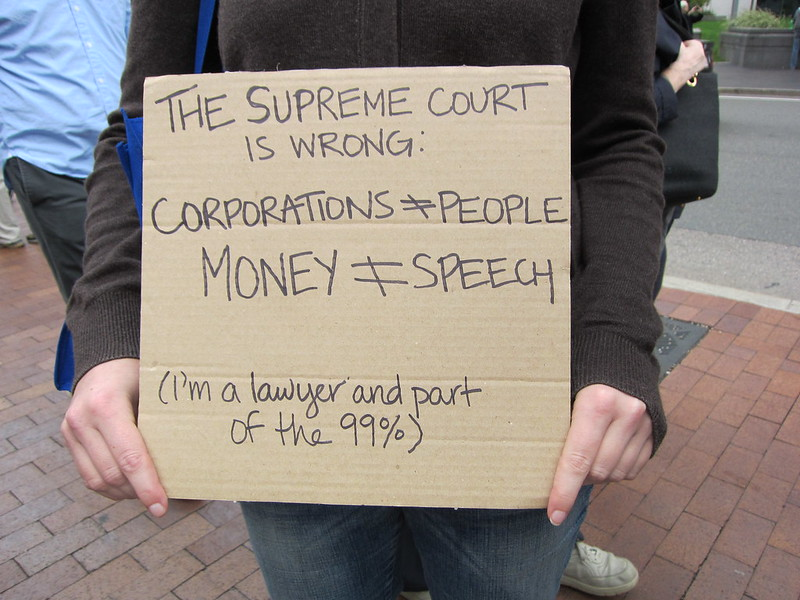 "A sign protesting the Supreme Court's 2010 decision ""Citizens United"" which enabled corporations and other outside groups to spend unlimited money on elections."