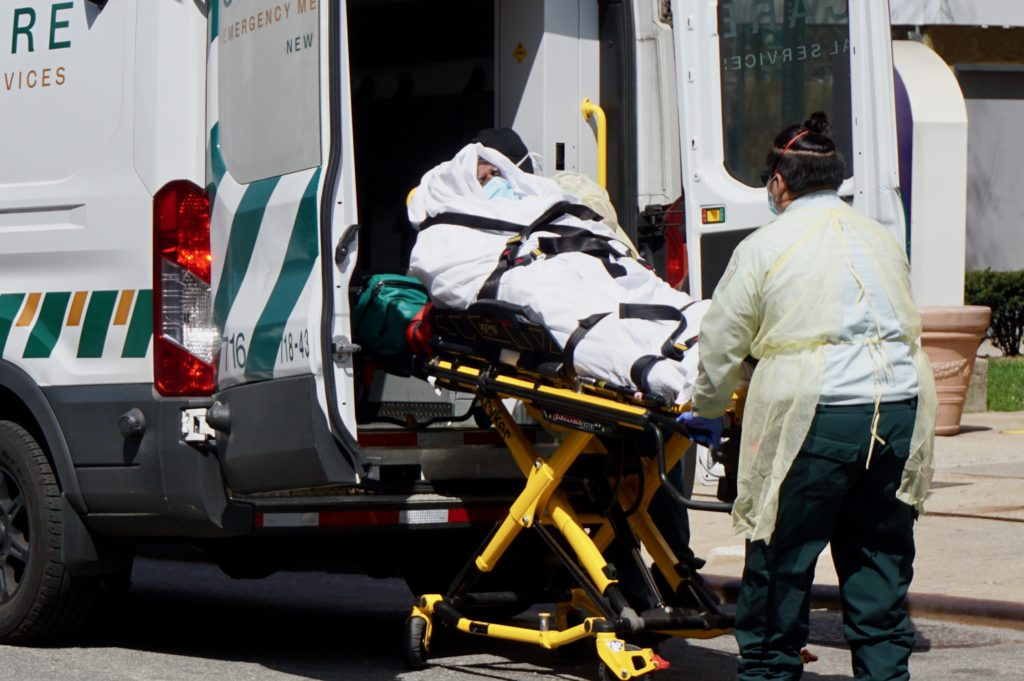 A patient is removed from an ambulance outside of NYU Langone Hospital in New York City.