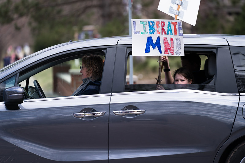 "A ""Liberate Minnesota"" protest at the Governor's residence on April 17, 2020."