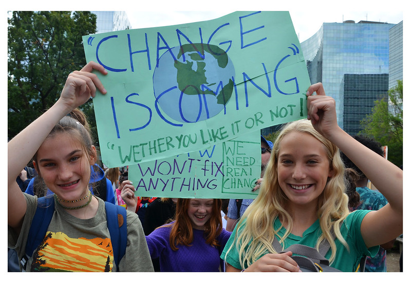 Two girls participate in an international climate strike on September 27, 2019. For young voters in the U.S., the issue of climate is a top concern.