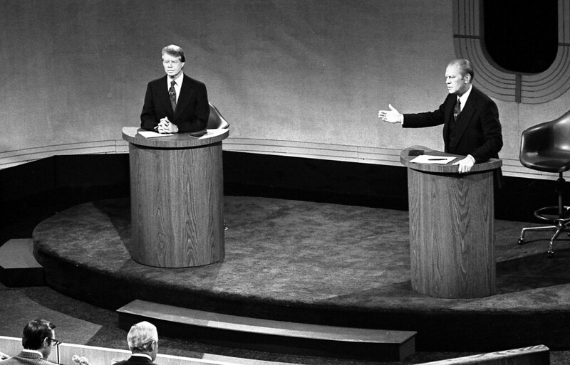 President Gerald Ford and Jimmy Carter meet at the Walnut Street Theater in Philadelphia to debate domestic policy during the first of the three Ford-Carter Debates, September 23, 1976.